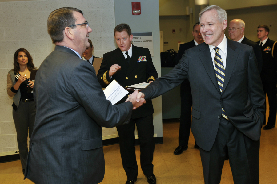 Deputy Secretary of Defense Ashton B. Carter, left, is greeted by Ray Mabus, Secretary of the Navy, as he arrives for the Navy Birthday celebration in the Pentagon Auditorium, October 9, 2012. (DoD Photo By Glenn Fawcett) (Released)