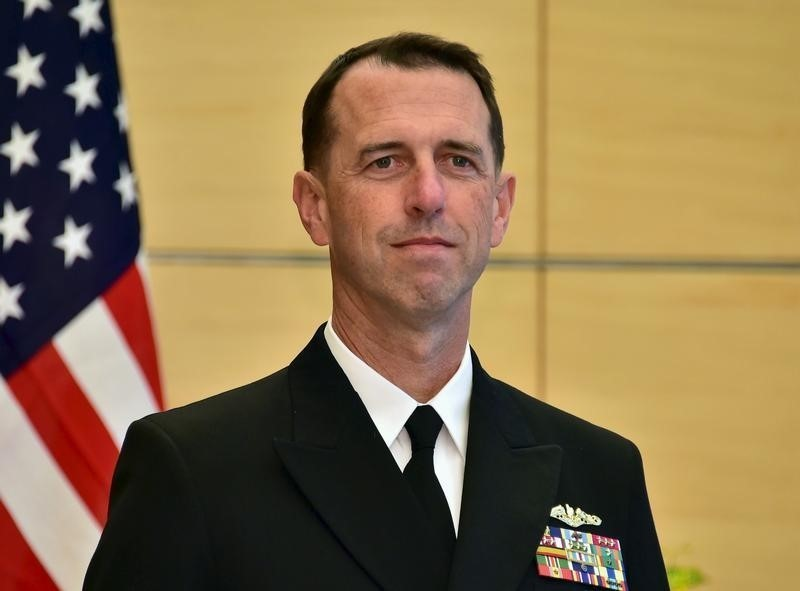 "U.S. Navy Admiral John Richardson (L), the U.S. chief of naval operations, waits for Japan's Prime Minister Shinzo Abe before their talks at Abe's official residence in Tokyo October 15, 2015. U.S. naval vessels sailing through international waters in the South China Sea, including areas claimed by China, cannot be considered provocative, the U.S. Navy's most senior uniformed officer said on Thursday, while a Chinese newspaper called for a firm response to any ""unscrupulous"" U.S. behavior. REUTERS/Yoshikazu Tsuno/Pool - RTS4JHV"