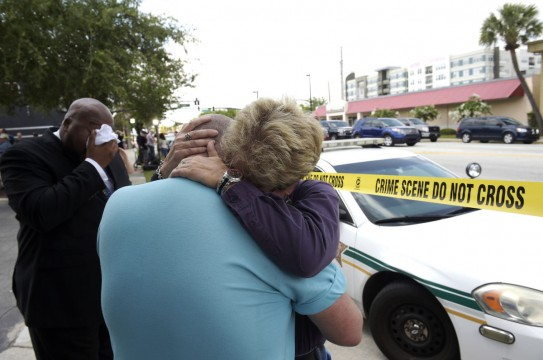 Terry DeCarlo, executive director of the LGBT Center of Central Florida, center, is comforted by Orlando City Commissioner Patty Sheehan, right, after a shooting involving multiple fatalities at a nightclub in Orlando, Fla., Sunday, June 12, 2016. (AP Photo/Phelan M. Ebenhack)