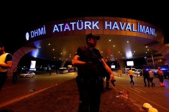 A riot police officer stands guard at the entrance of the Ataturk airport in Istanbul, Turkey, following a multiple suicide bombing, early June 29, 2016. REUTERS/Murad Sezer